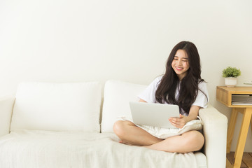 Young asian lady chilling at home