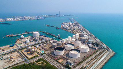 Aerial view Oil refinery. with a background of the sea and sky. The factory is located in the middle of nature and no emissions. The area around the air pure. Top view.