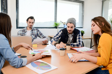 group of young cool hipster business people in casual wear working together in meeting room of a startup company