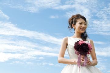 Young woman wearing a wedding dress