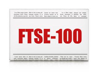 Stock market indexes concept: newspaper headline FTSE-100