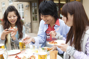 Young people eating at an outdoor cafe