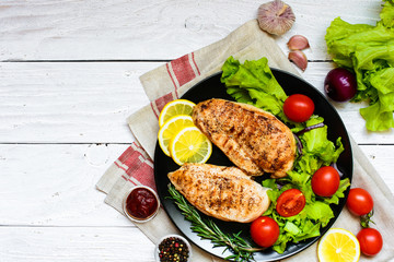 grilled chicken breast with herbs and vegetables