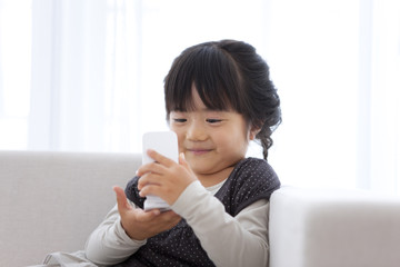 Young Girl Using Mobile Phone