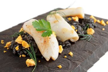 Black squid ink rice and fried calamar