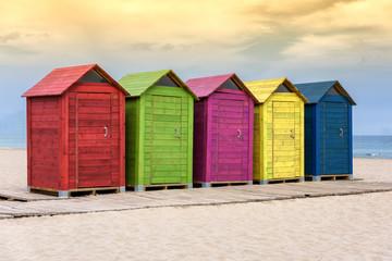 Colorful beach huts on sandy beach
