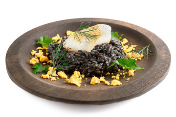 Black squid ink risotto with lightly seared calamar