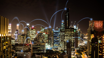 Connected city concept: A wireless business network connecting offices in the business skyscrapers of Singapore