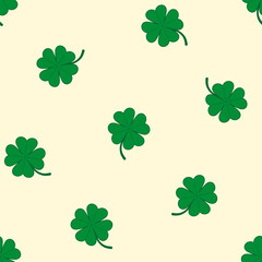 Green four-leaf clovers on yellow background. Seamless pattern.
