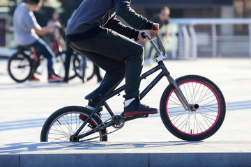 the urban cyclist in motion on the sidewalk