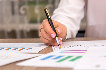 Business woman accounts and analysis data for home budget.