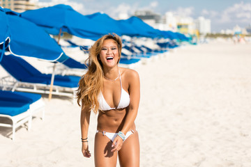 Vacation travel concept. Beautiful young happy sexy asian girl in swimwear at beach resort