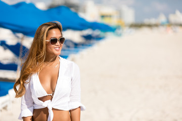 Happy, young, fresh, attractive smiling asian girl in bikini on beach resort vacation