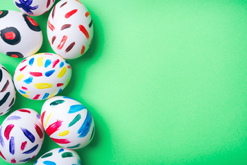 Easter eggs in a green background. Easter bunny. Rabbit. Easter ideas. Easter eggs. Space for text.