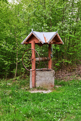 An old wooden well in the forest