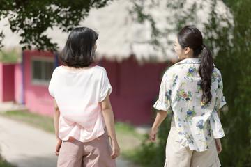 Rear view of two women