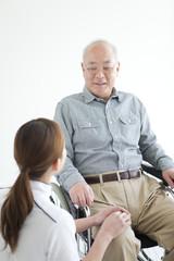 Female Nurse with Senior Male Patient