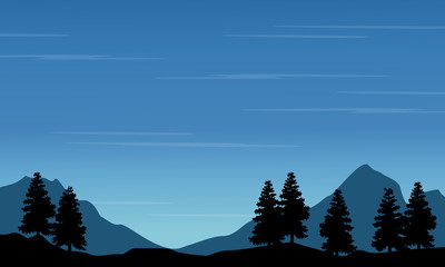 Silhouette of spruce with mountain landscape