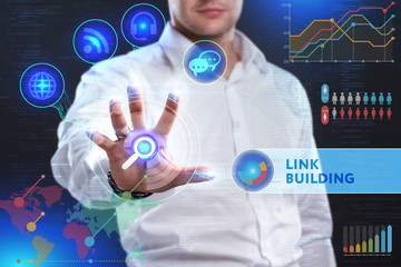 Business, Technology, Internet and network concept. Business man working on the tablet of the future, select on the virtual display: Link building