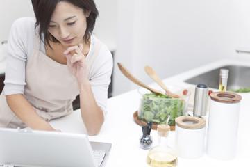A woman looking at computer