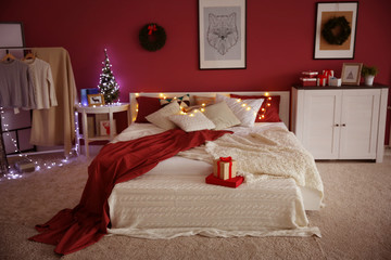 Modern bedroom with Christmas decor and cozy double bed