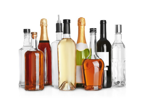 Different bottles of wine and spirits on white background
