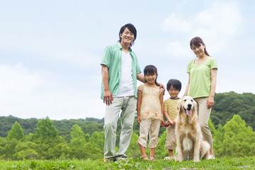 Family standing with their dog