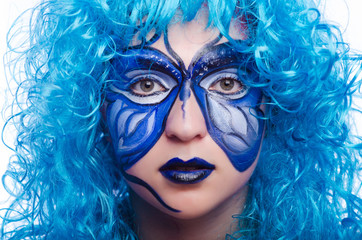 Face paint of woman with butterfly