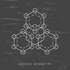 Sacred geometry sign on black grunge background