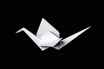 Origami crane isolated on black background