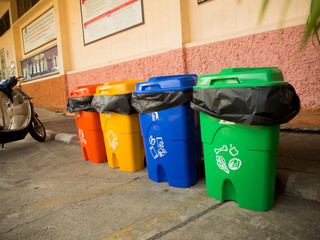 Three colorful recycle bins isolated