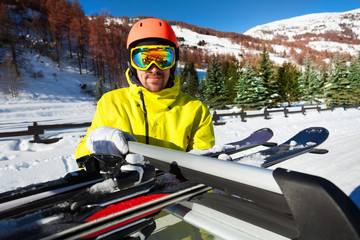 Man ready to start ski trip at beautiful mountains