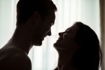 Blurred faces of couple. People smiling to each other. Missed you so much, honey. Wall mural