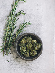 Overhead view of herbs and cannabis on table