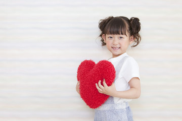 A girl holding heart