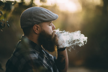 Man smoking a joint outdoors