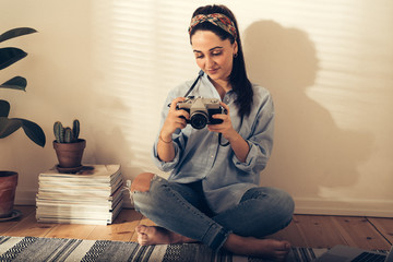 Pretty trendy young woman checking a photo