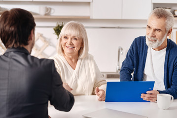 Successful lawyer working with aged couple in the house