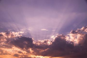Sun shines and cloud  on purple sky