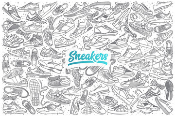 Hand drawn sneakers doodle set background with blue lettering in vector