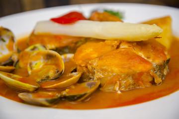Stewed and garnished fish dish