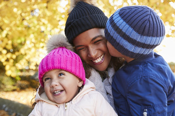 Outdoor Autumn Portrait Of Mother With Children
