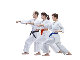 On a white background three adult athletes are beating punch arm isolated