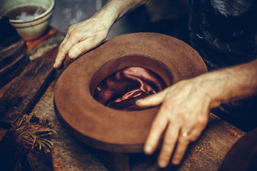 Hatter making a hat