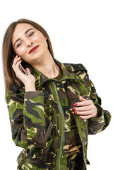 woman soldier with a mobile phone in camouflage military uniform