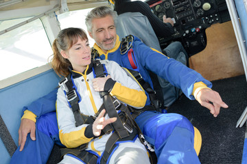 Man and woman preparing for a sky dive