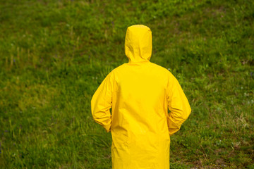 man in yellow raincoat back