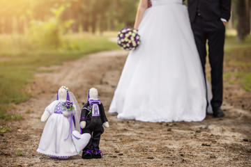 Wedding concept, rabbits or bunny toys in shape wedding couple in forest. Textile bride and groom