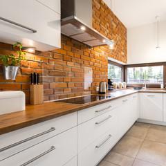 Brick wall in modern kitchen