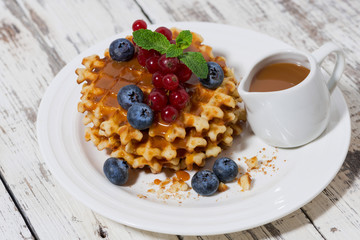 waffles with berries and caramel